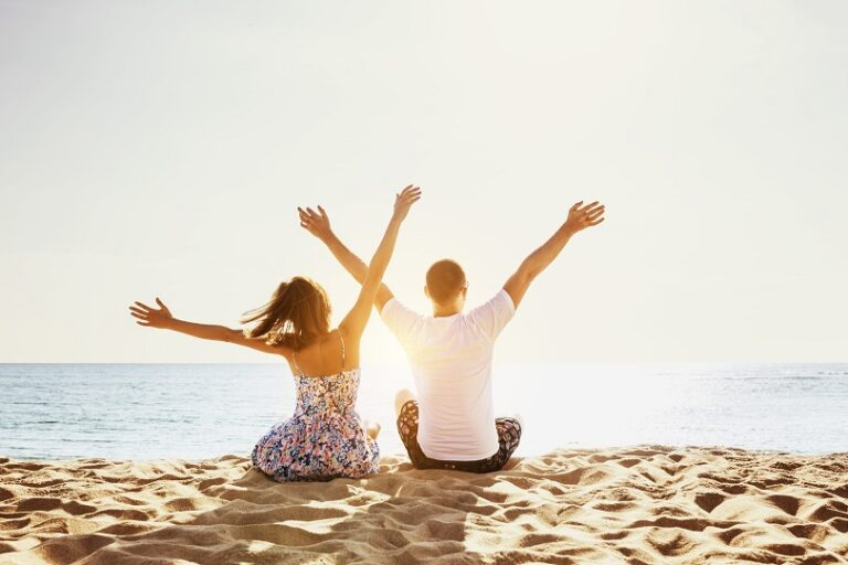 Happy couple beach holidays concept